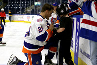 Sound Tigers skate with the players. Apr 9, 2017.